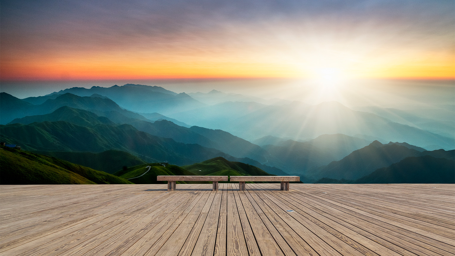 Bench on a mountain at sunrise