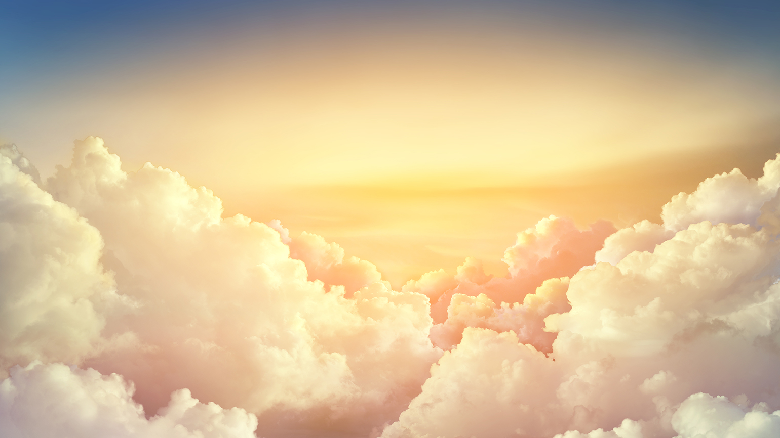 Puffy white clouds with a heavenly glow
