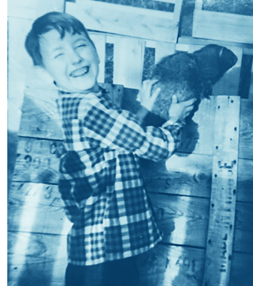 Young Robert Boggs holds Crisco the groundhog