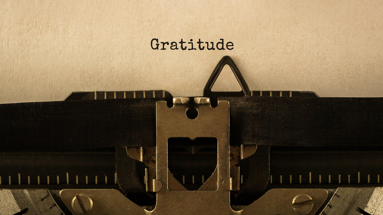 the word 'gratitude' typewritten on a page