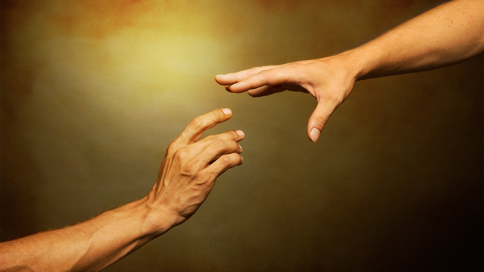 Two outstretched reach for each other