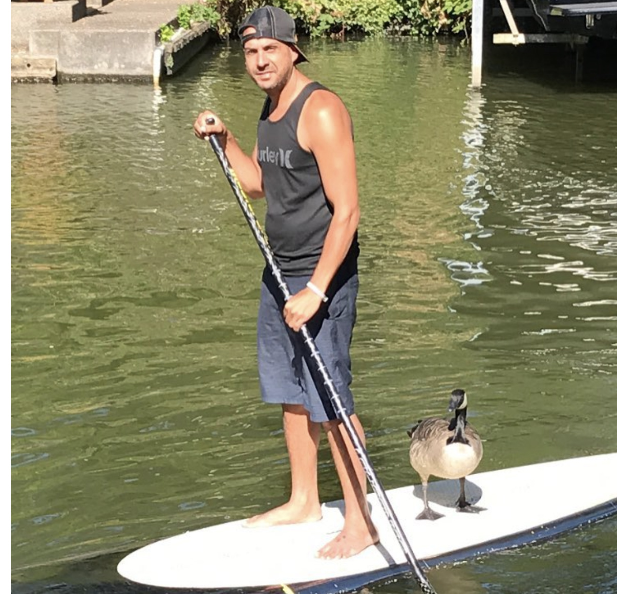 Mike and Kyle paddleboarding