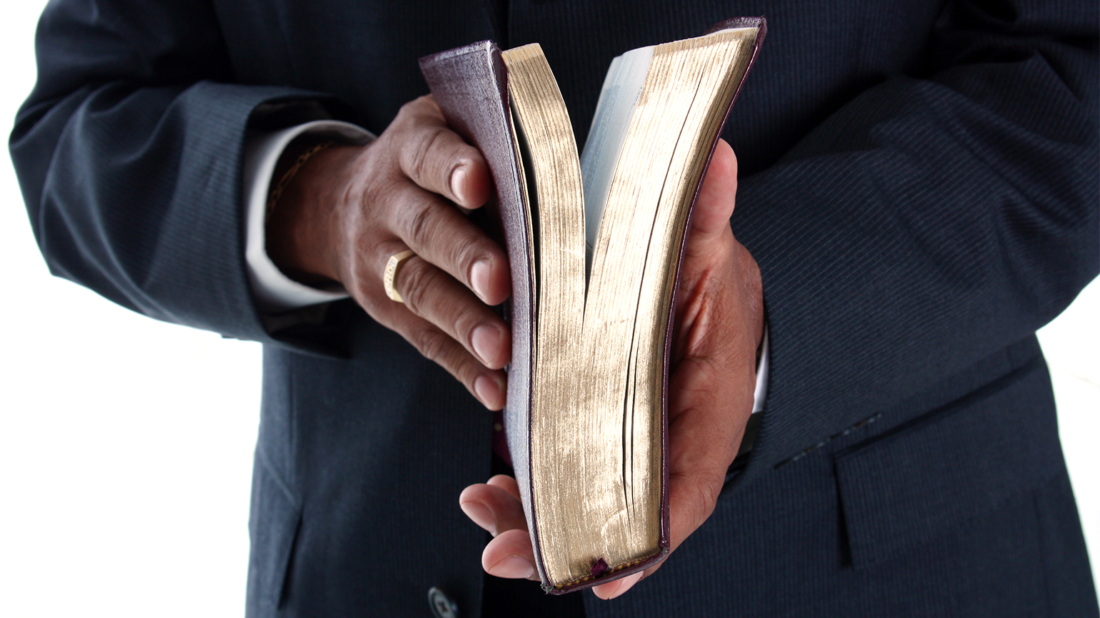 Pastor holding a bible