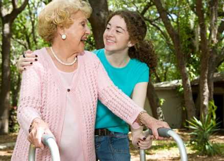 Earth angels: Grandmother being helped by granddaughter