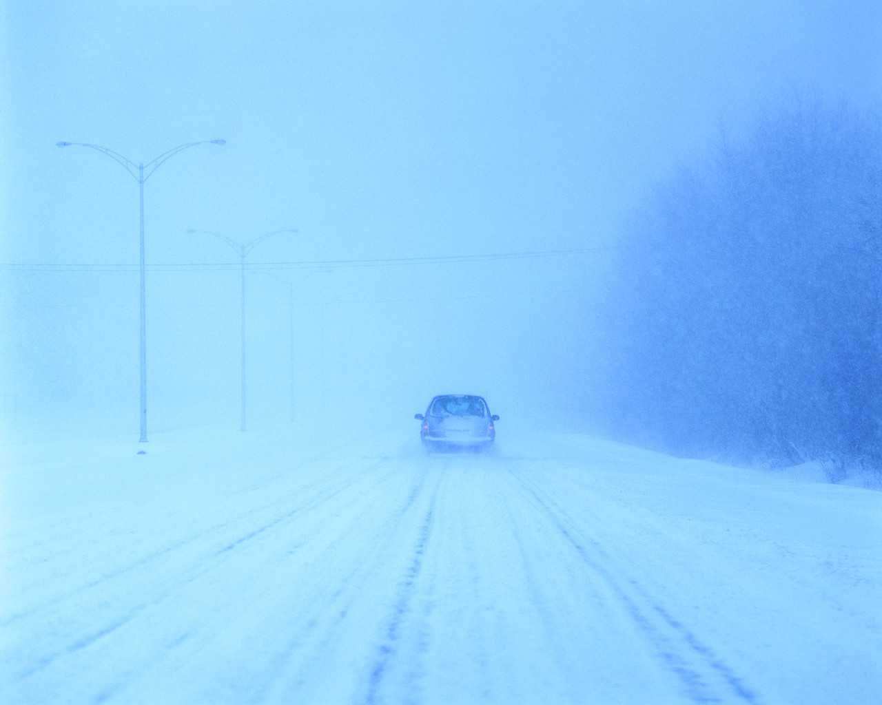 Car in blizzard conditions.