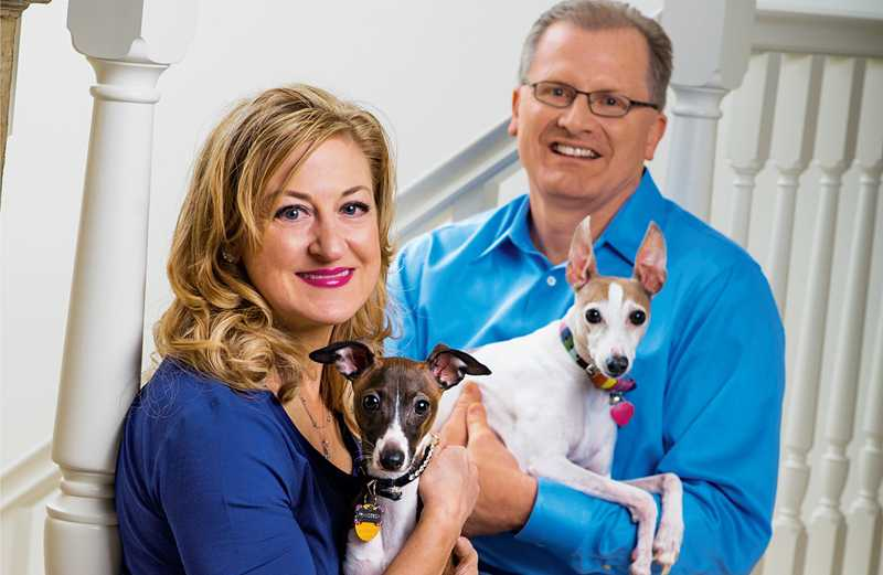 The Carlsons and their current pack, Francesca (left) and Leo