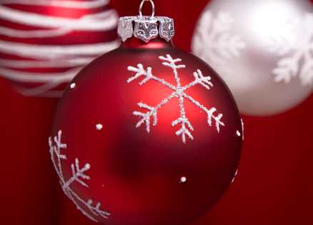 A red Christmas ornament with silver glitter