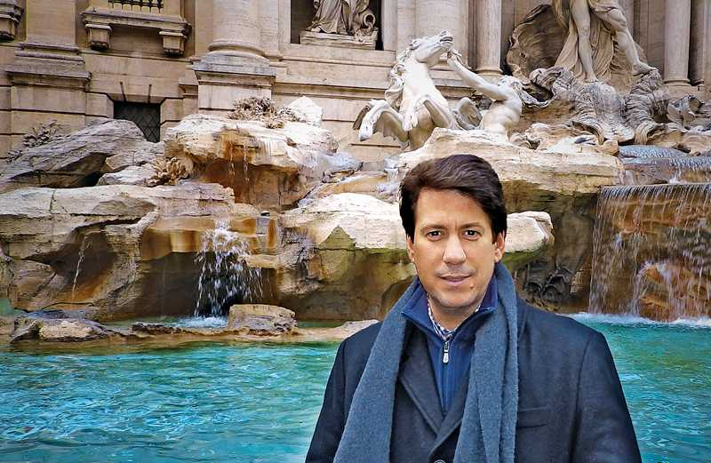 Anthony DeStefano beside the Trevi Fountain