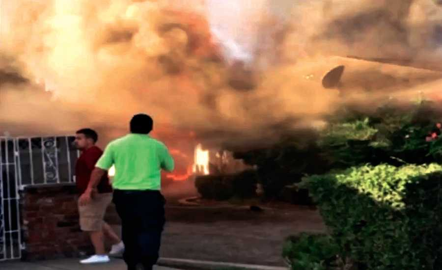 A screengrab from video taken of a house fire in Fresno, California