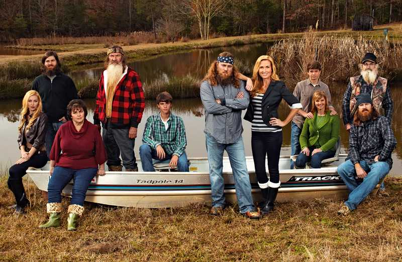 Korie Robertson (standing), husband Willie, and the Robertson family