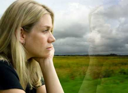 A sad woman looking out the window.