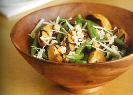 Green Bean and Grilled Peach Salad in a wooden bowl