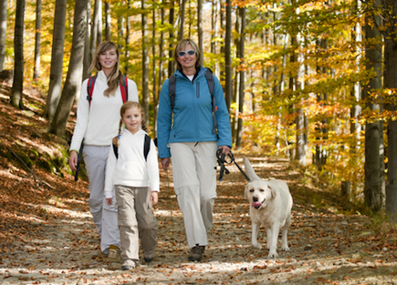 Happy family hiking in autumn.