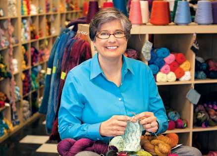 Lisa Bogart in the knitting store where she believes her angels guided her.