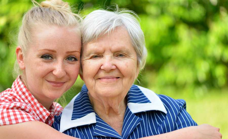 Guideposts: A young woman lovingly embraces her grandmother.