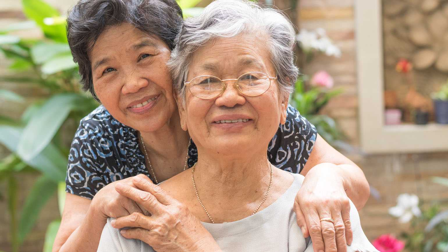 A family caregiver and her client; Getty Images