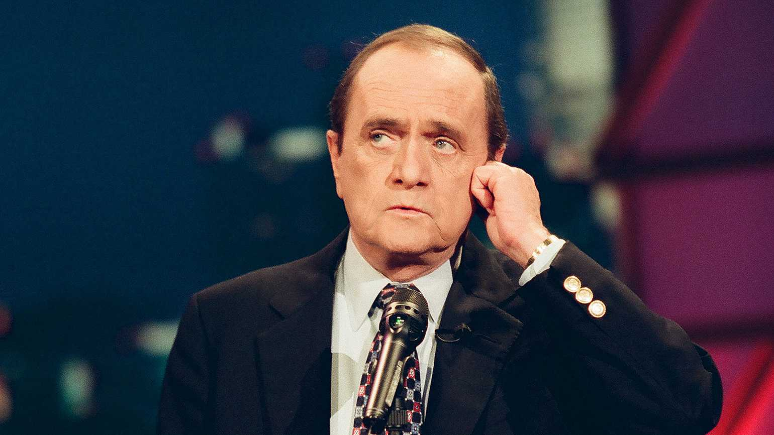 Comedian Bob Newhart performs one of his famous phone-conversation comedy routines