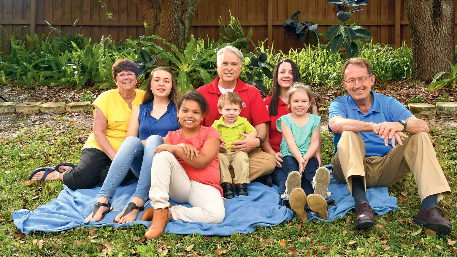 With parents in the back row, grandparents on either end, the Burklew kids take center stage.