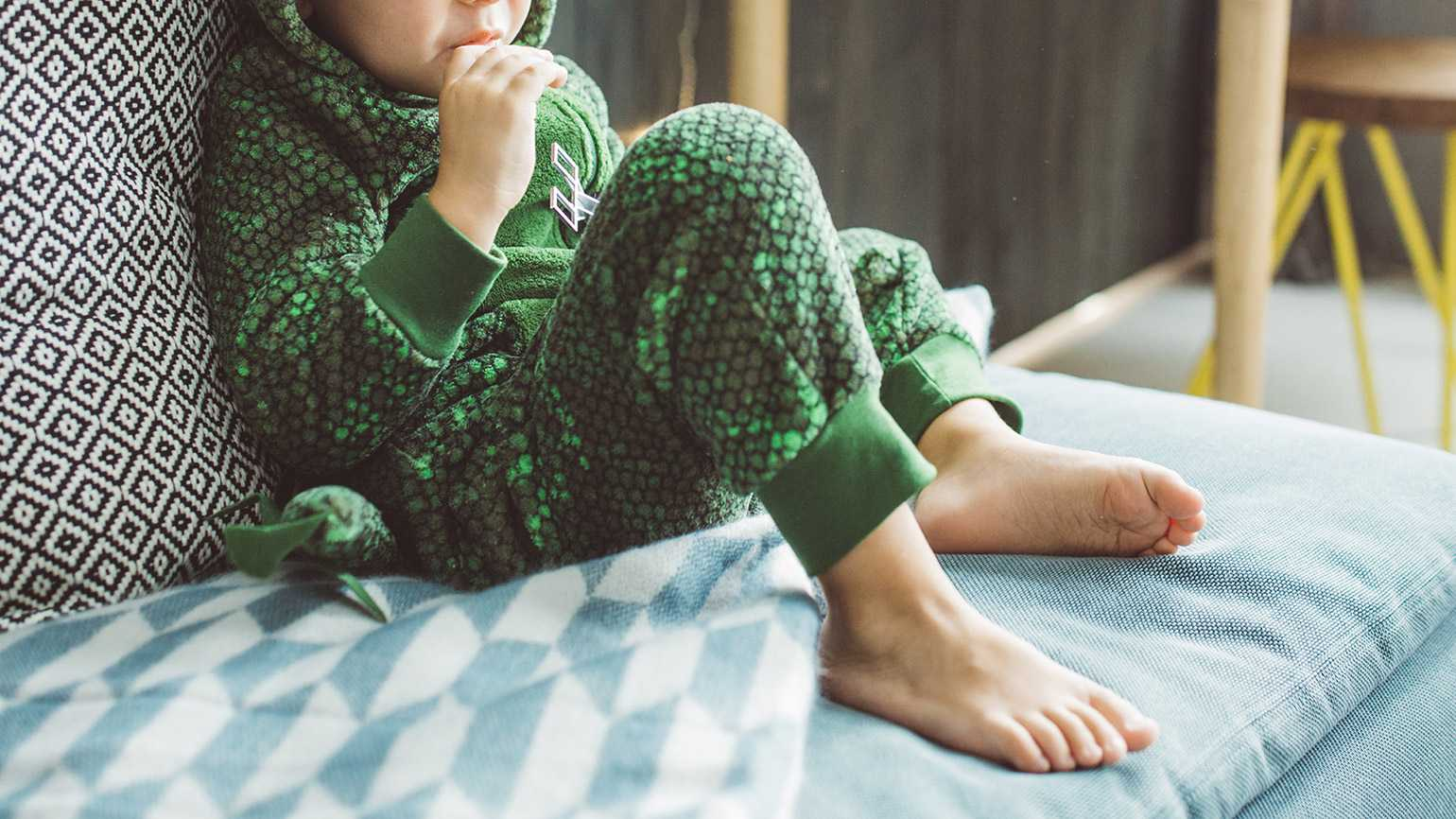 A young boy in dinosaur pajamas; Getty Images