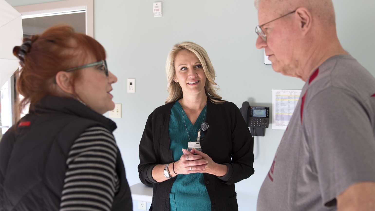 Everette in discussion with his wife Karla and a doctor.