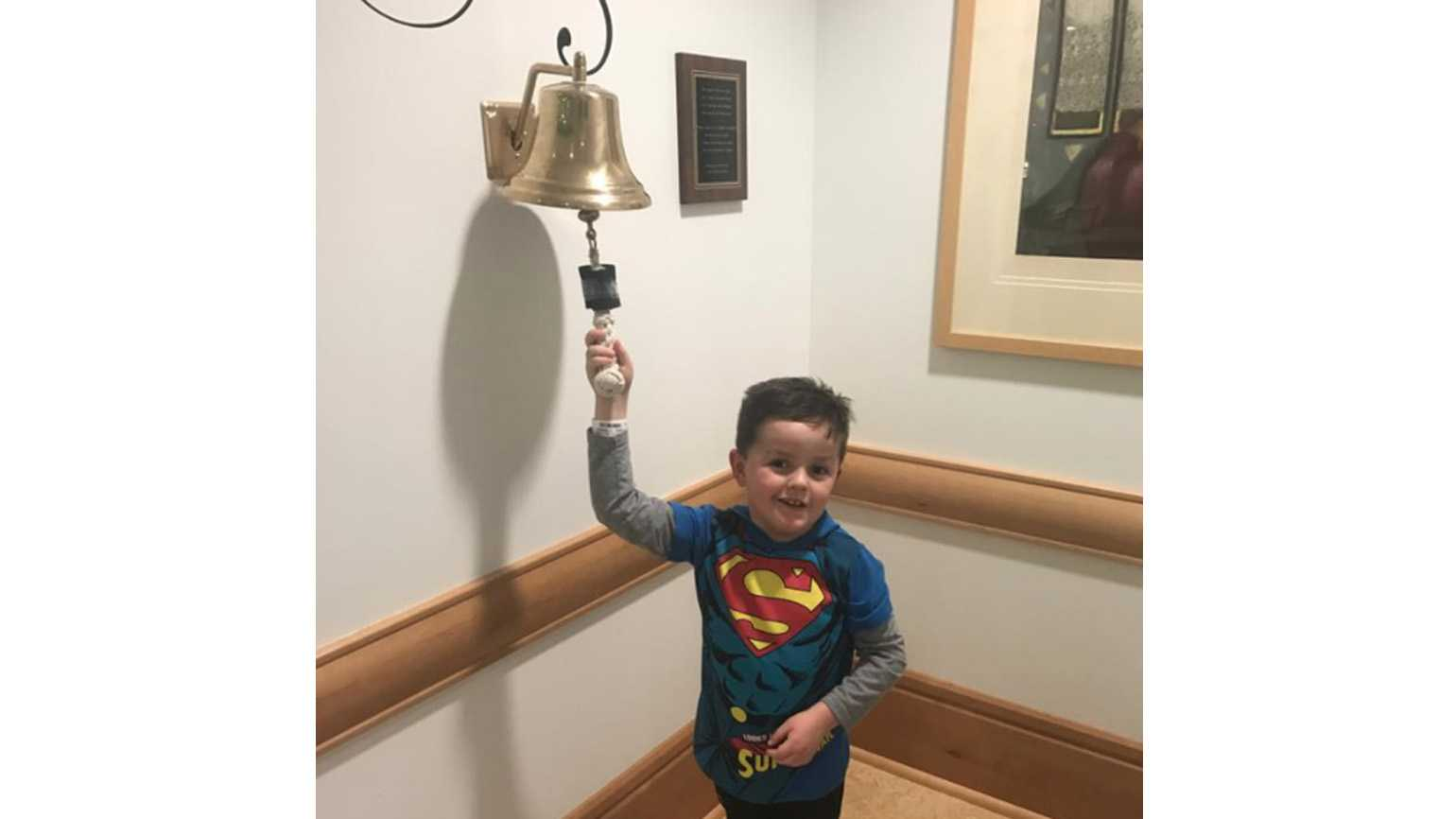 Jimmy Spagnolo, 6, rings a bell to signify the end of his cancer treatments at the Children's Hospital of Pittsburgh.