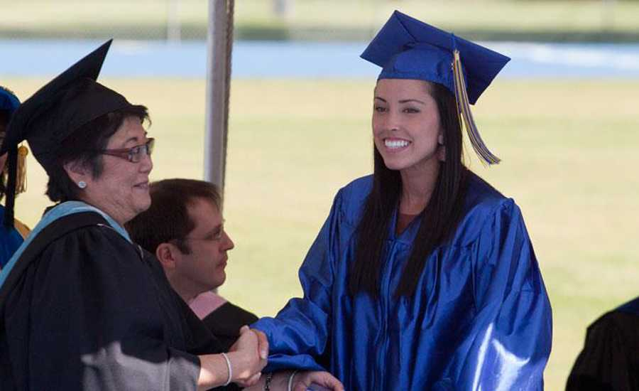 Guideposts: Josey walks across the stage to receive her diploma