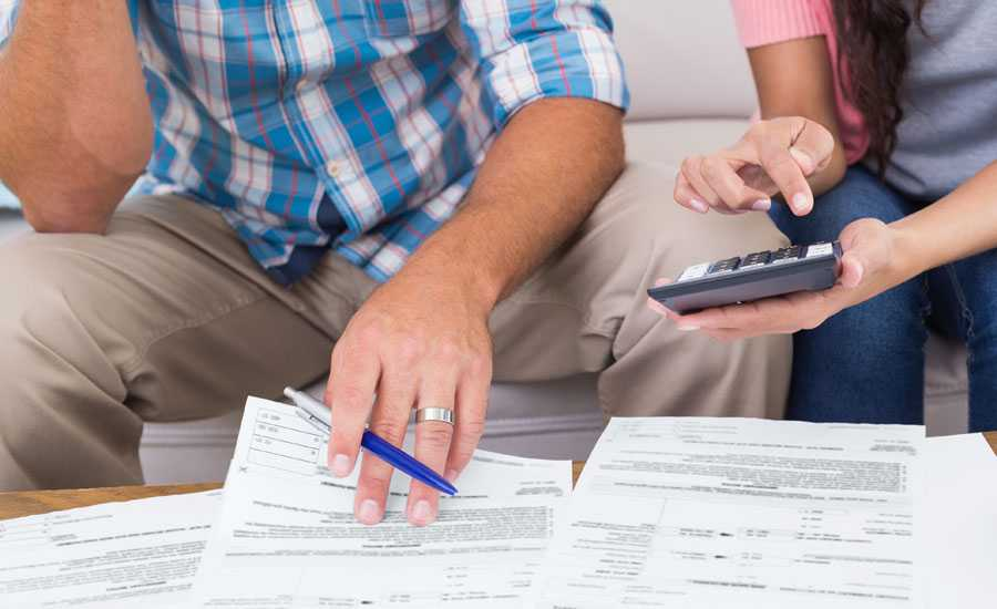 A young married couple works together on their finances