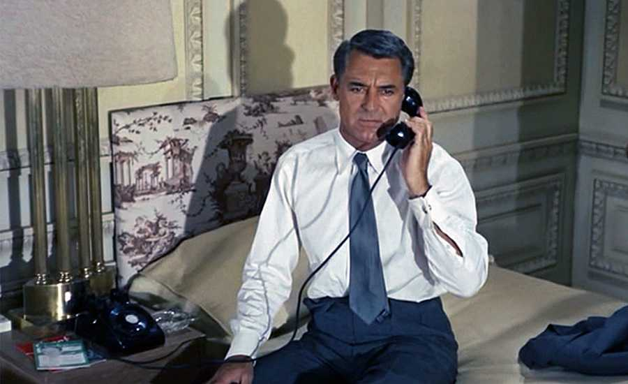 Cary Grant takes a call in a room at NYC's Plaza Hotel