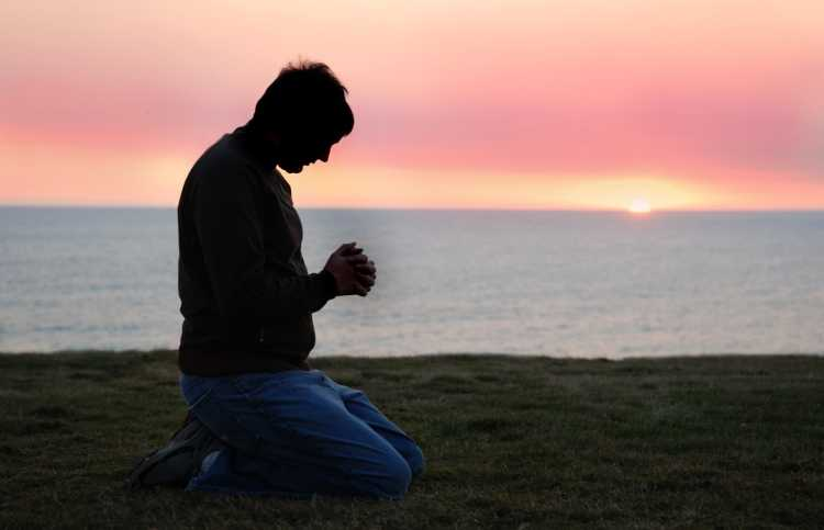 man praying during sunrise; discover the who, what, when and why of prayer