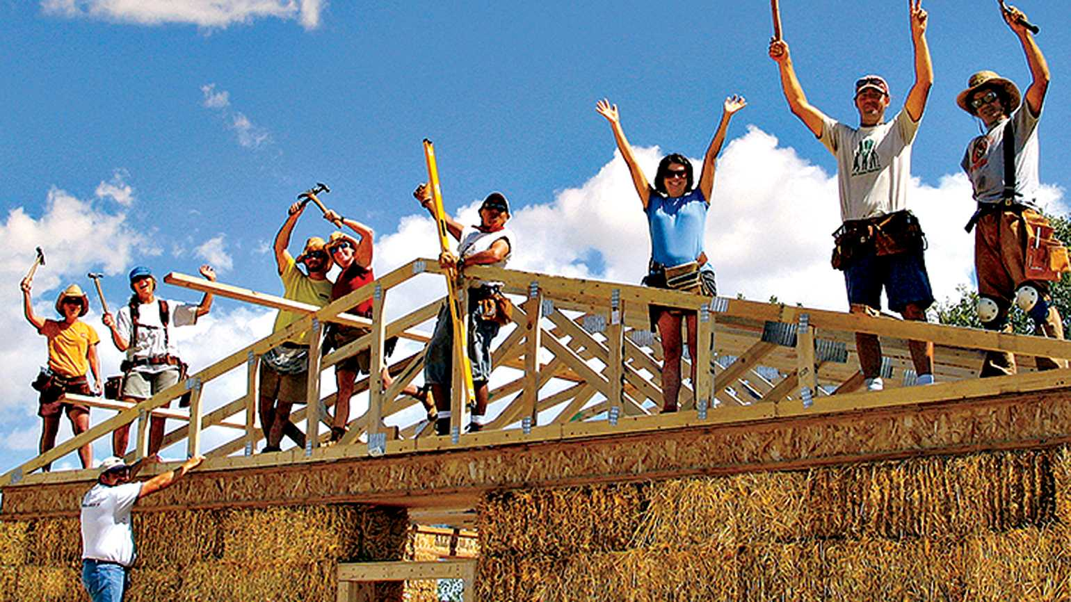 Guideposts volunteers work on a construction project for Red Feather Development Group