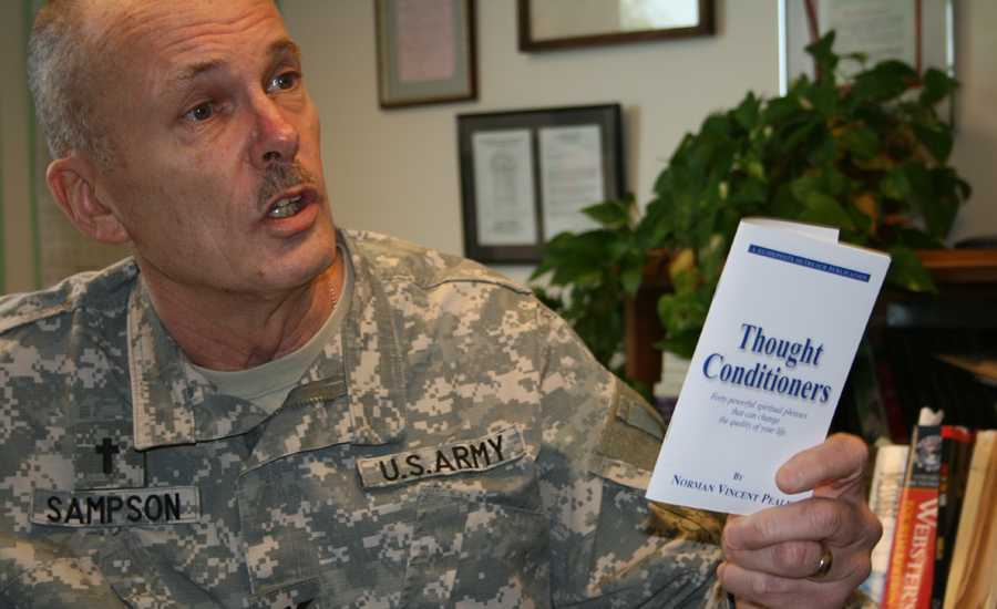 Chaplain Sampson with a Guideposts' Thought Conditioners booklet