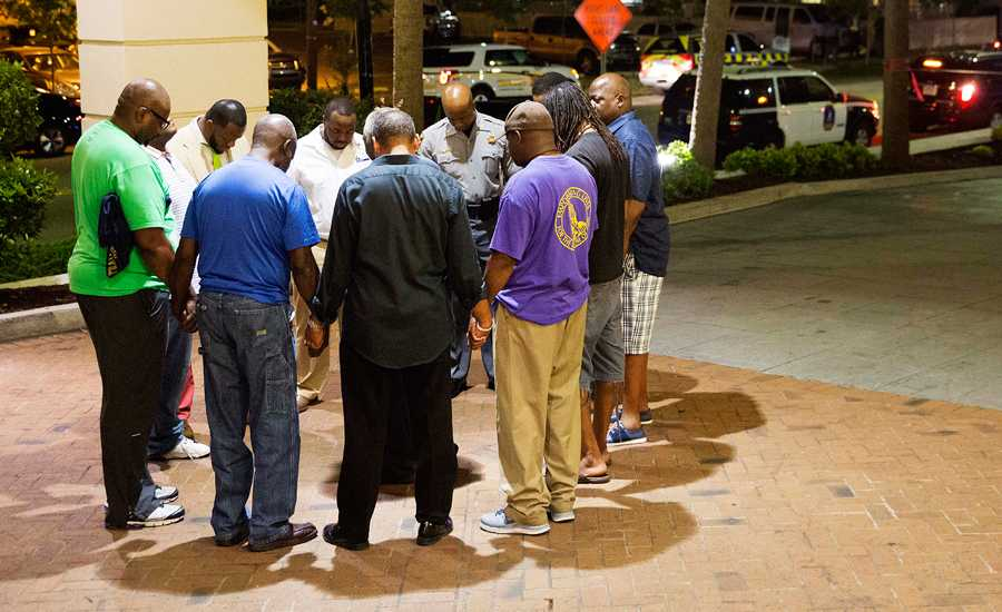 Worshippers gather to pray down the street from the Emanuel AME Church in Charleston, S.C.