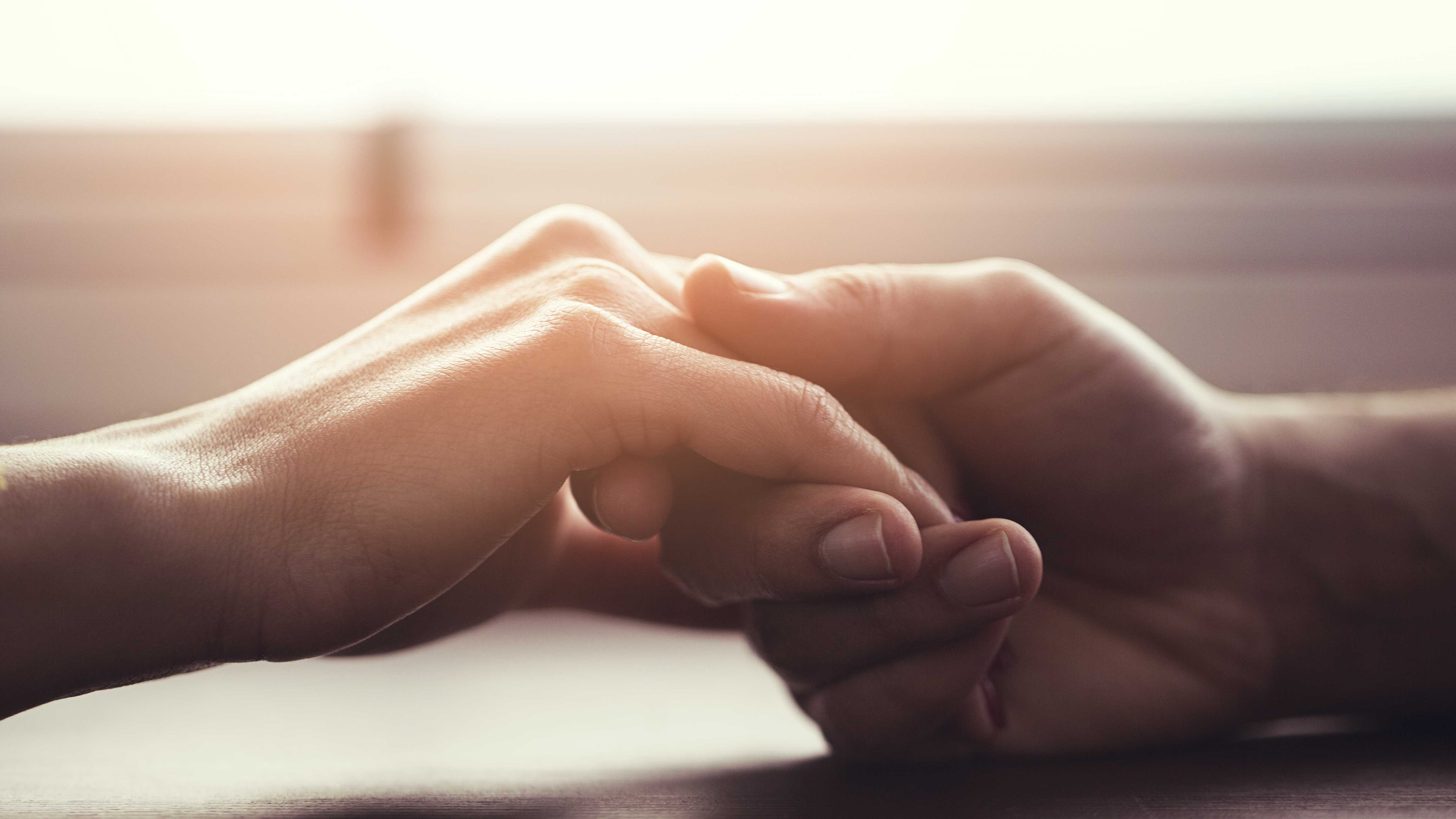the healing power of touch, two hands touching