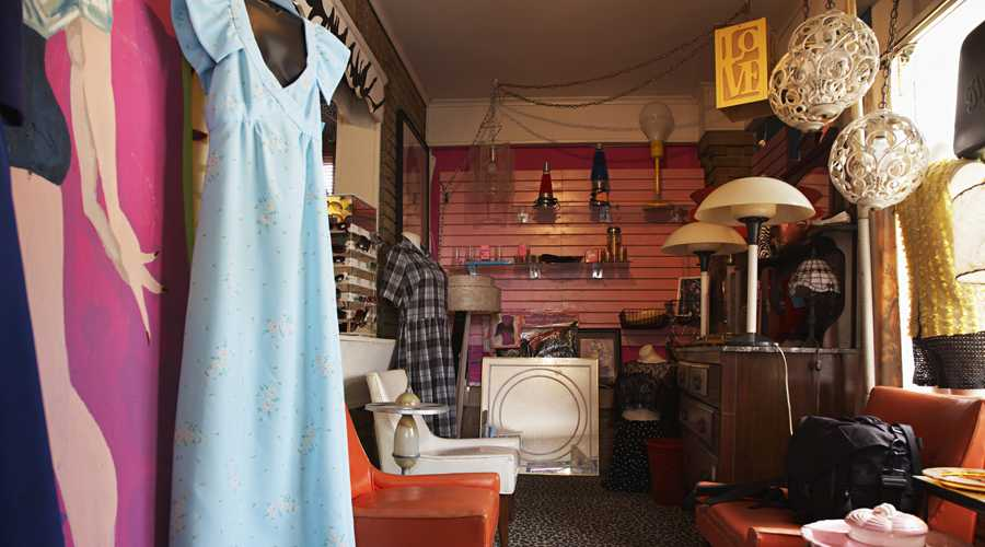 An image of clothes, furniture at a thrift store, save money on holiday shopping   Guideposts
