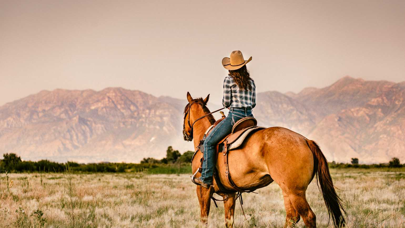 Woman Horseback Riding at Sunset (Getty Images)