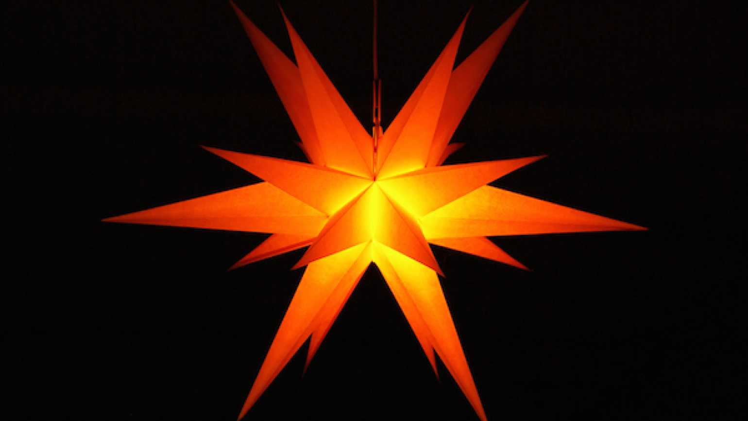 A Christmas star leads to a moment of family grace while decorating the Christmas tree.