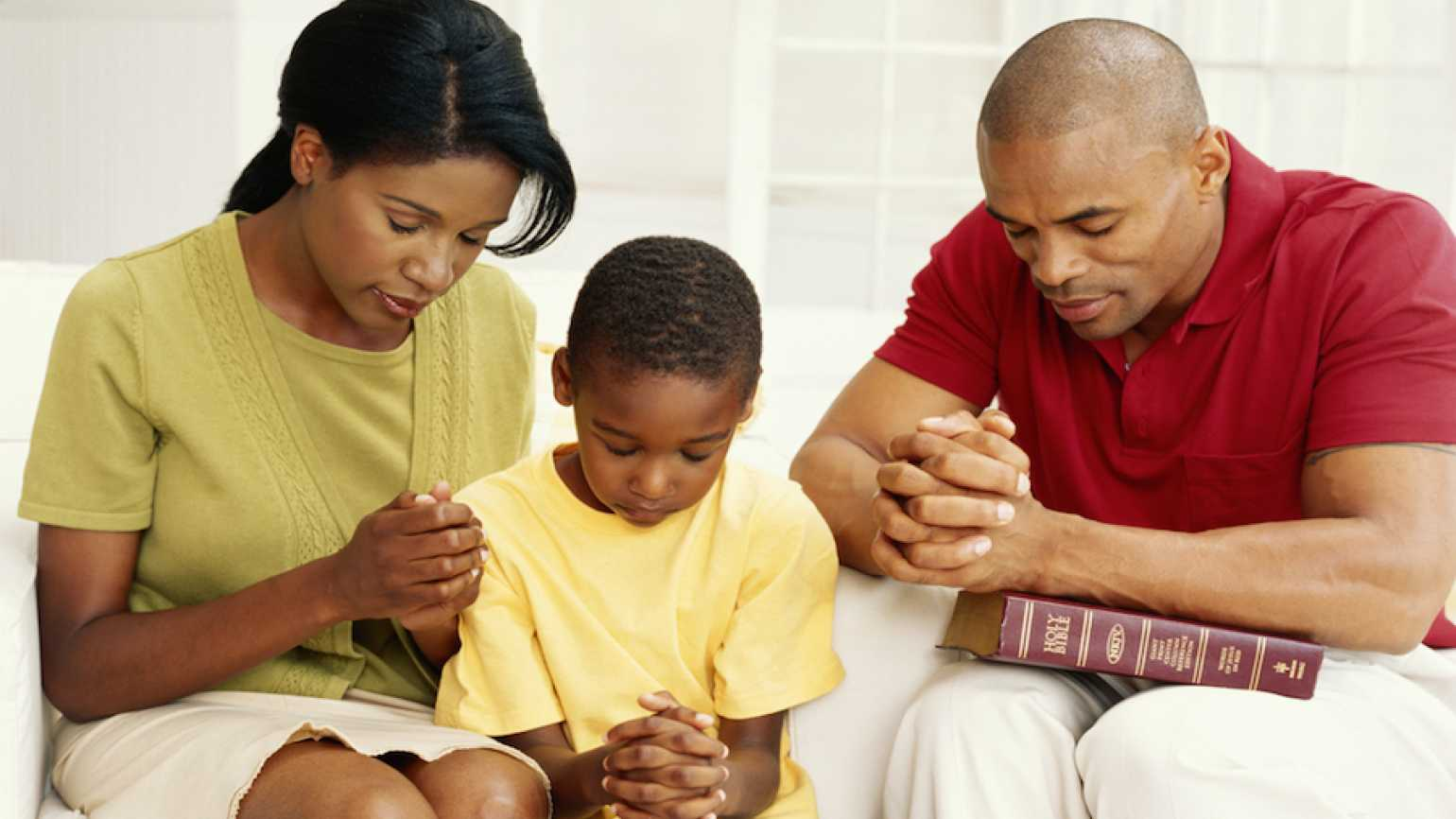 A family praying in their home.