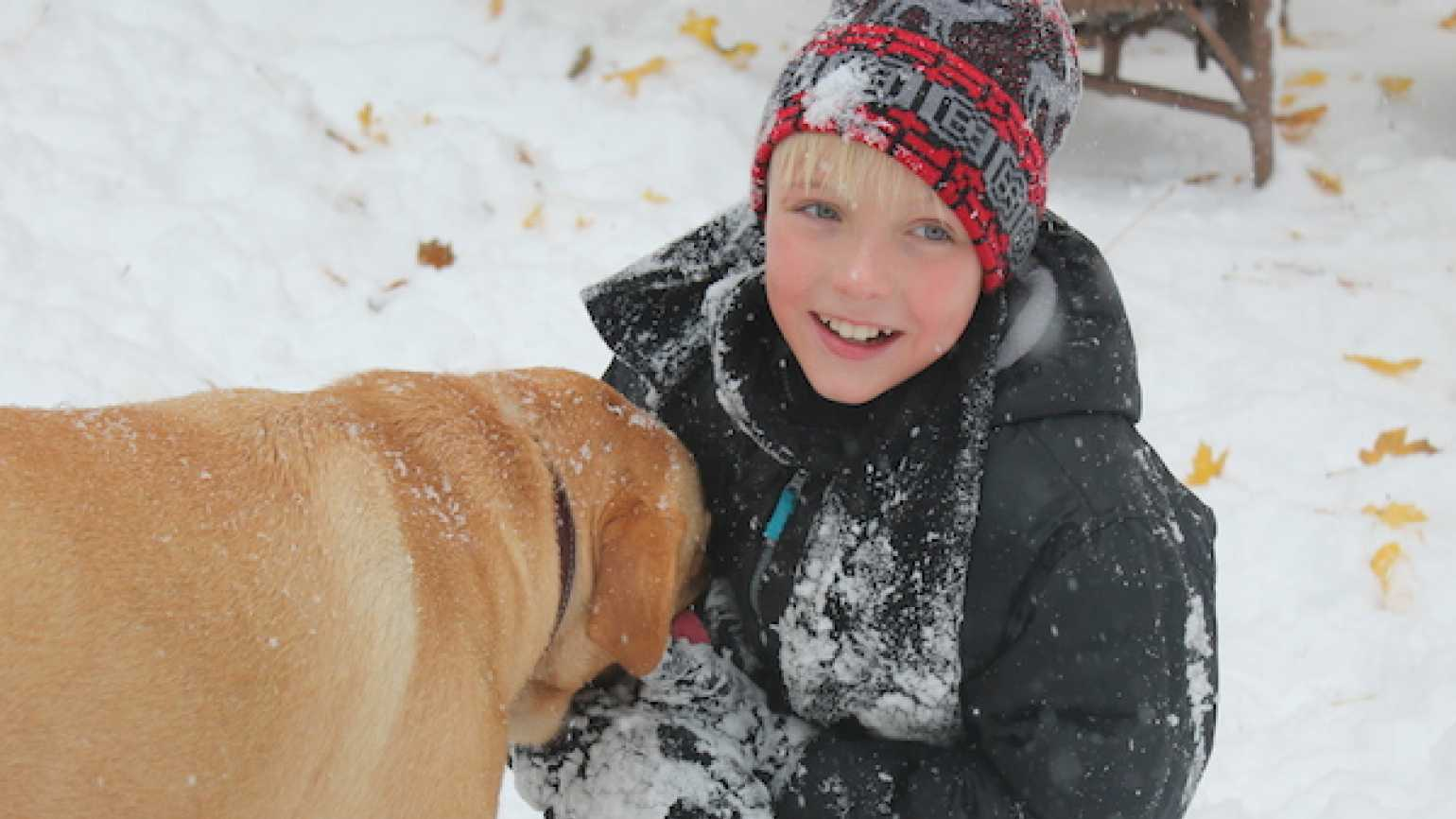 Guideposts blogger Shawnelle Eliasen's son Isaiah and dog Rugby play in the season's first snow.