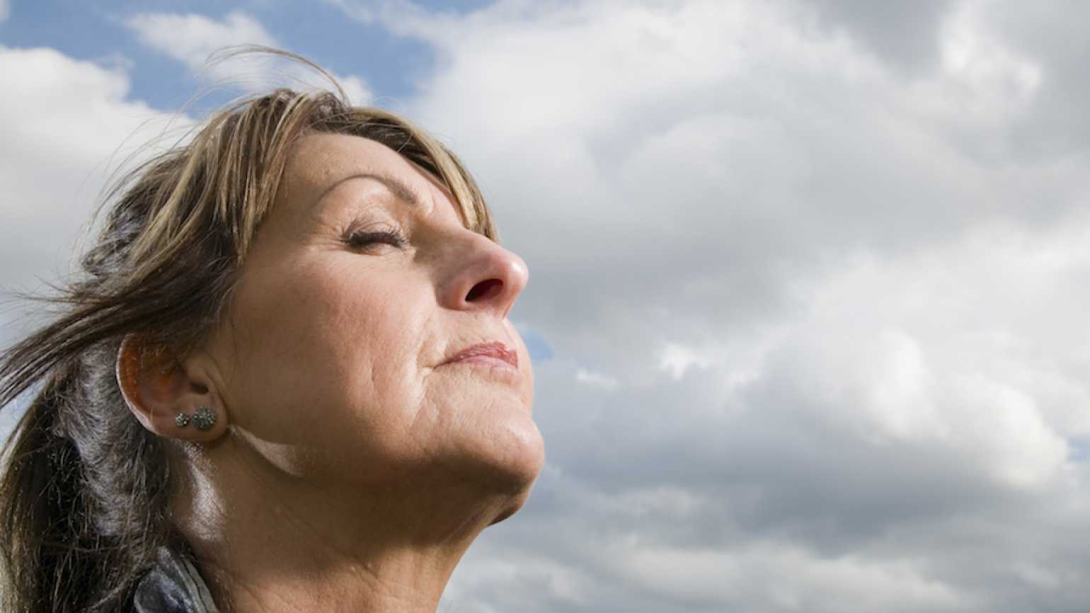 Woman being still, with eyes closed. Thinkstock.