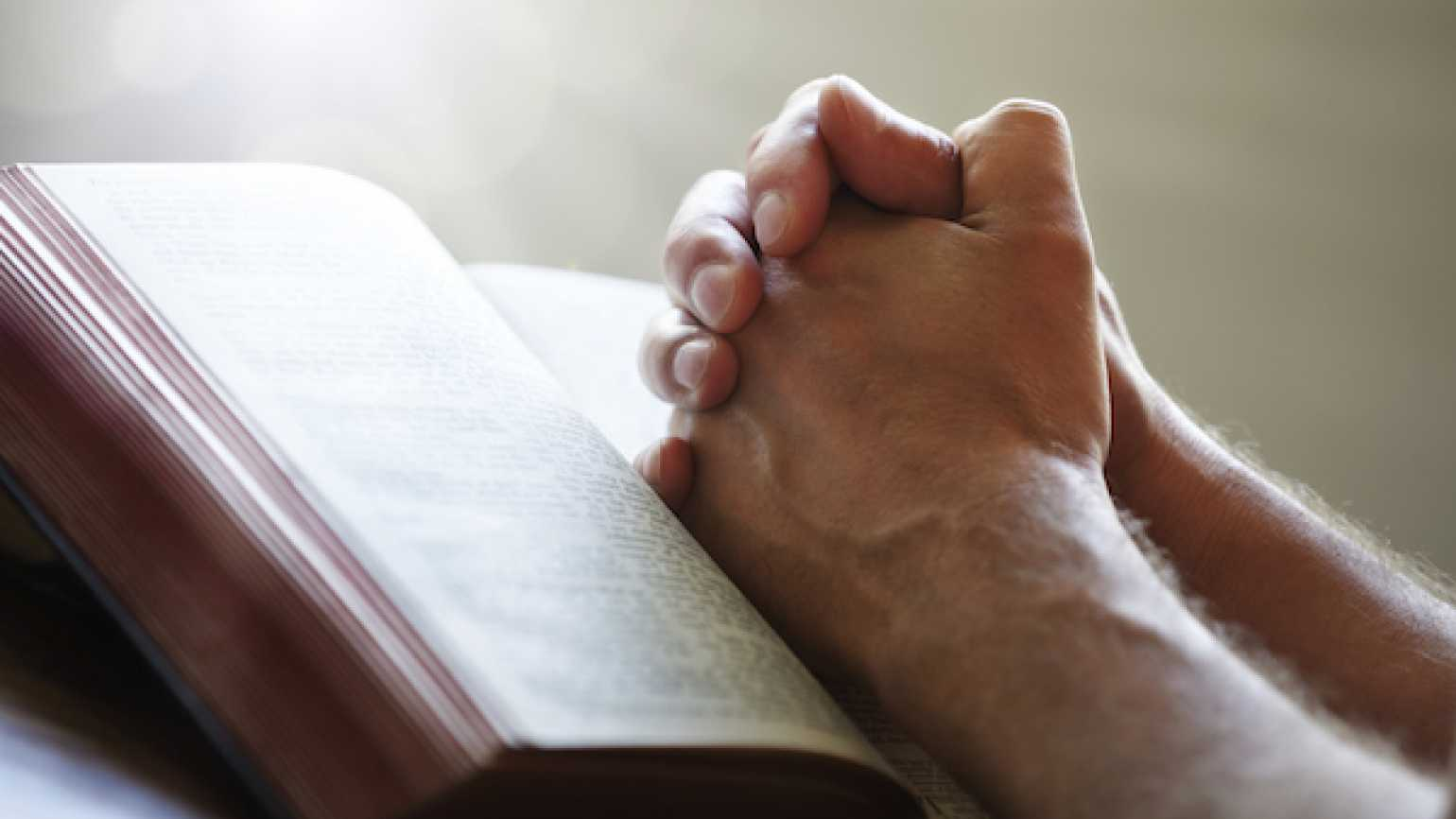 Studies explore the power of prayer and faith in helping others.