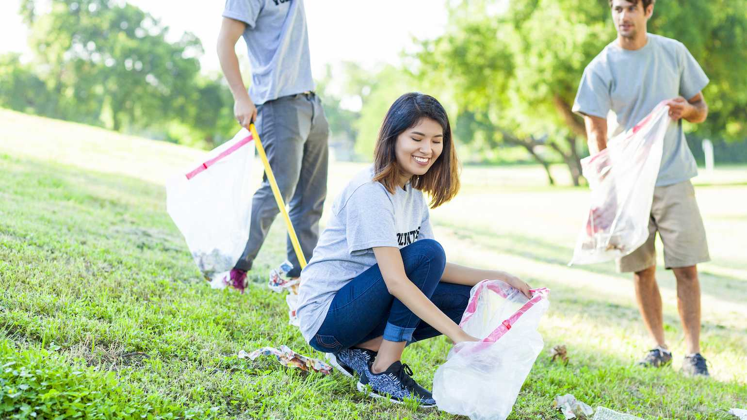 Helping pick up trash in a park