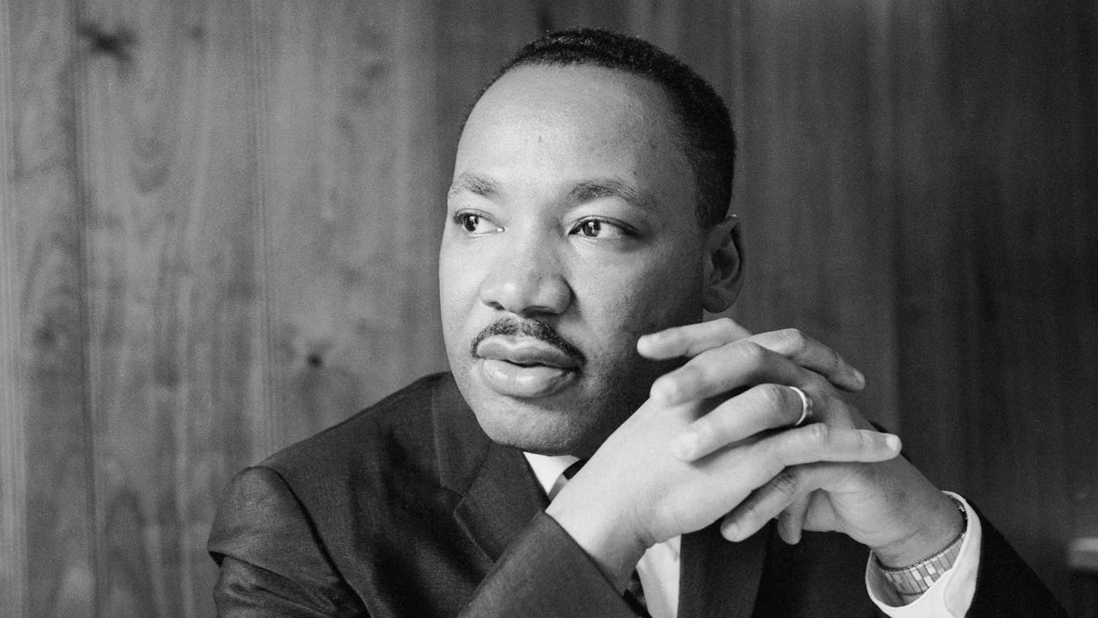 Martin Luther King Jr. listening at a meeting of the SCLC staff at an Atlanta restaurant