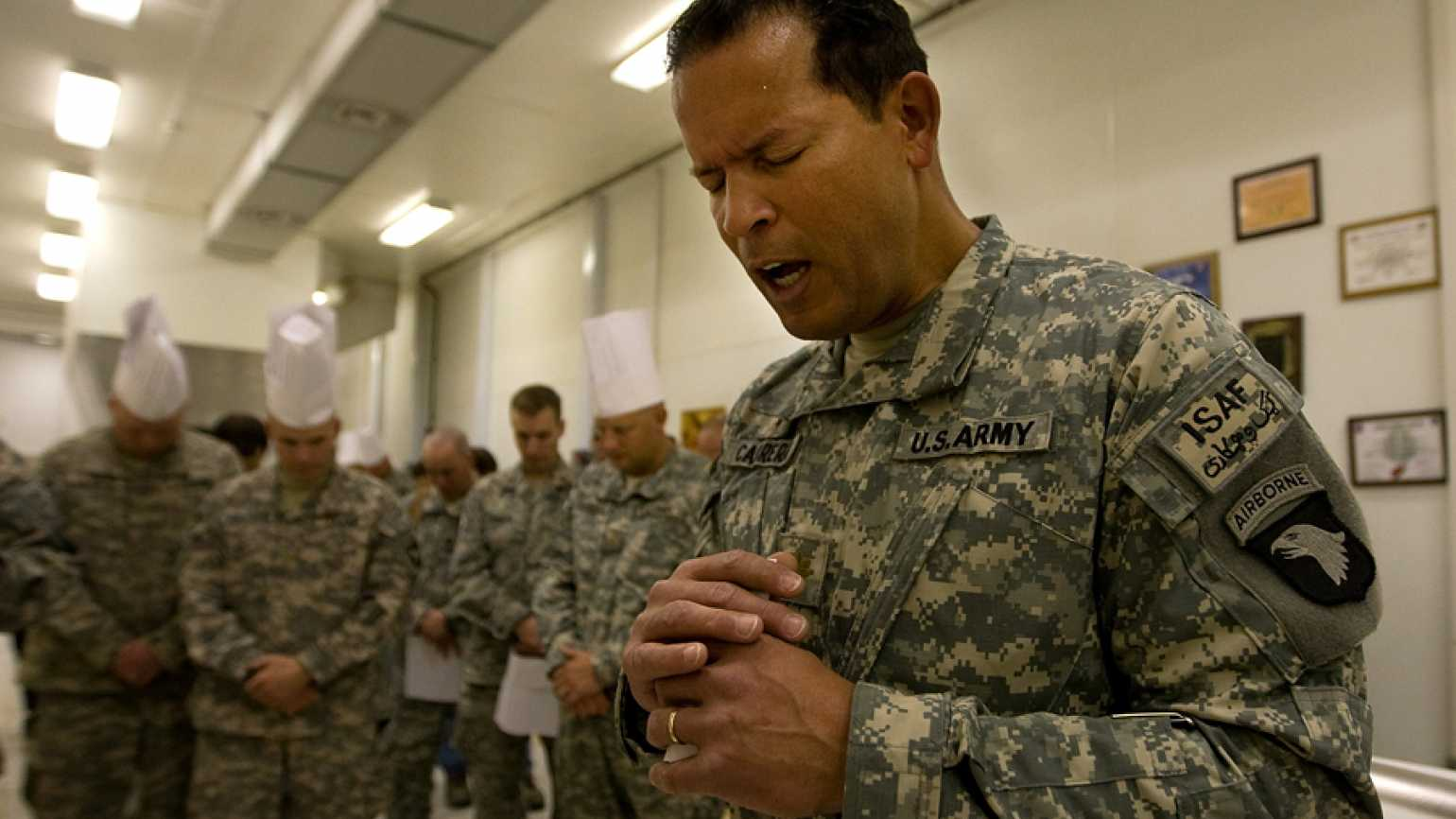 Military Chaplain prays with troops in Afghanistan