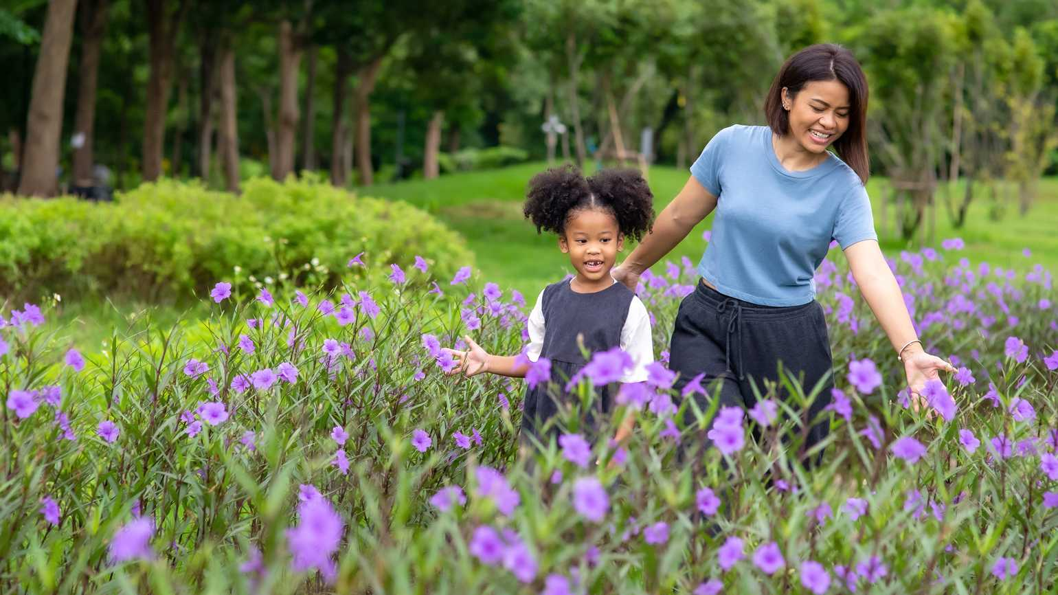 Mother and daughter in a field of flowers; Getty Images