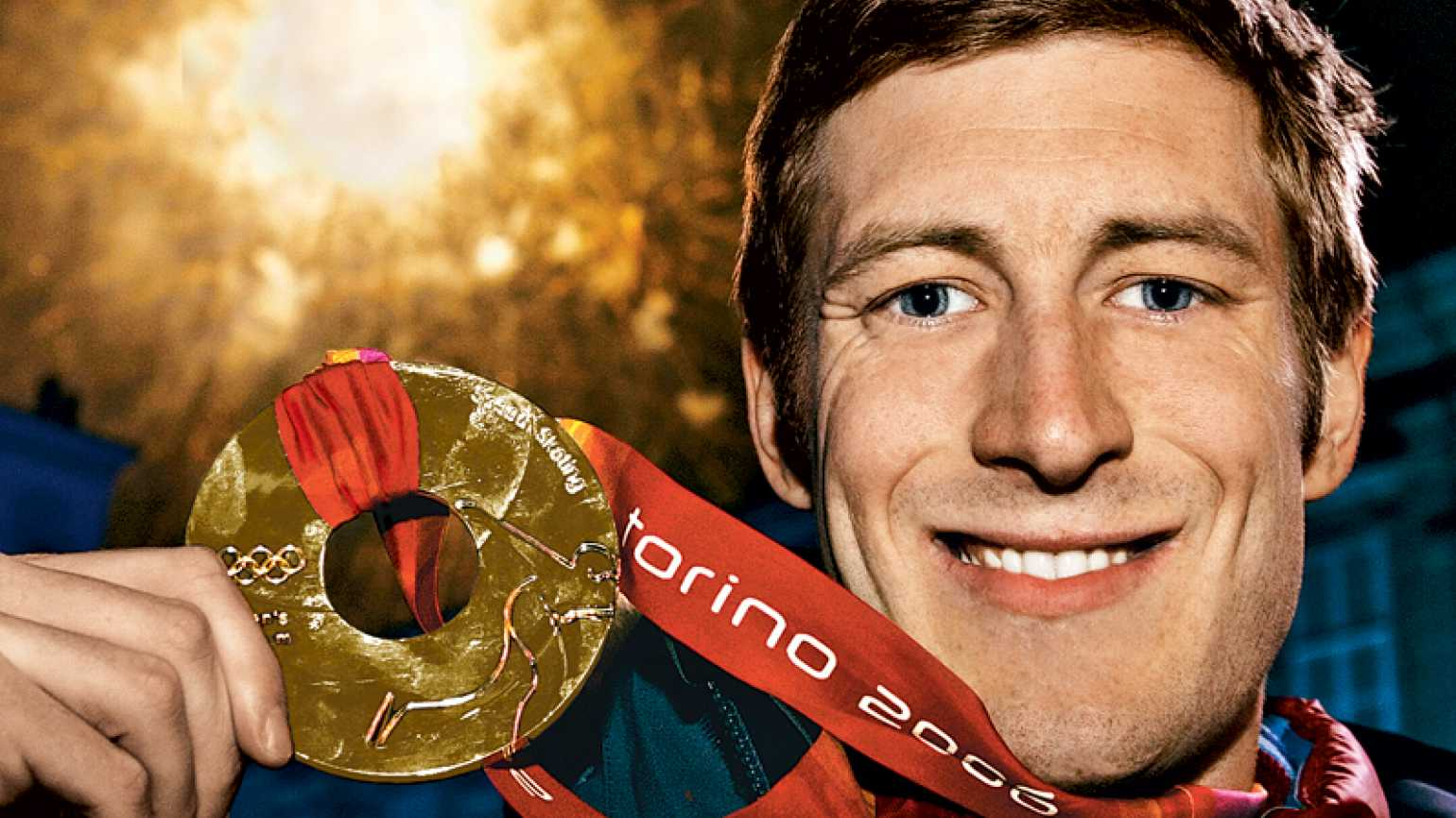 Joey Cheek poses with his gold medal in Torino.