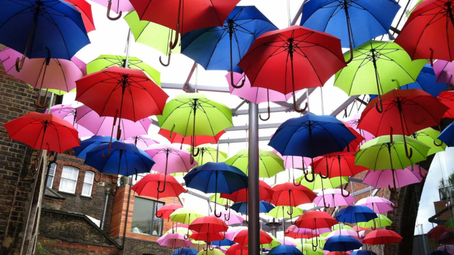 A lunch-break miracle: brightly colored umbrellas suspended in the air in London