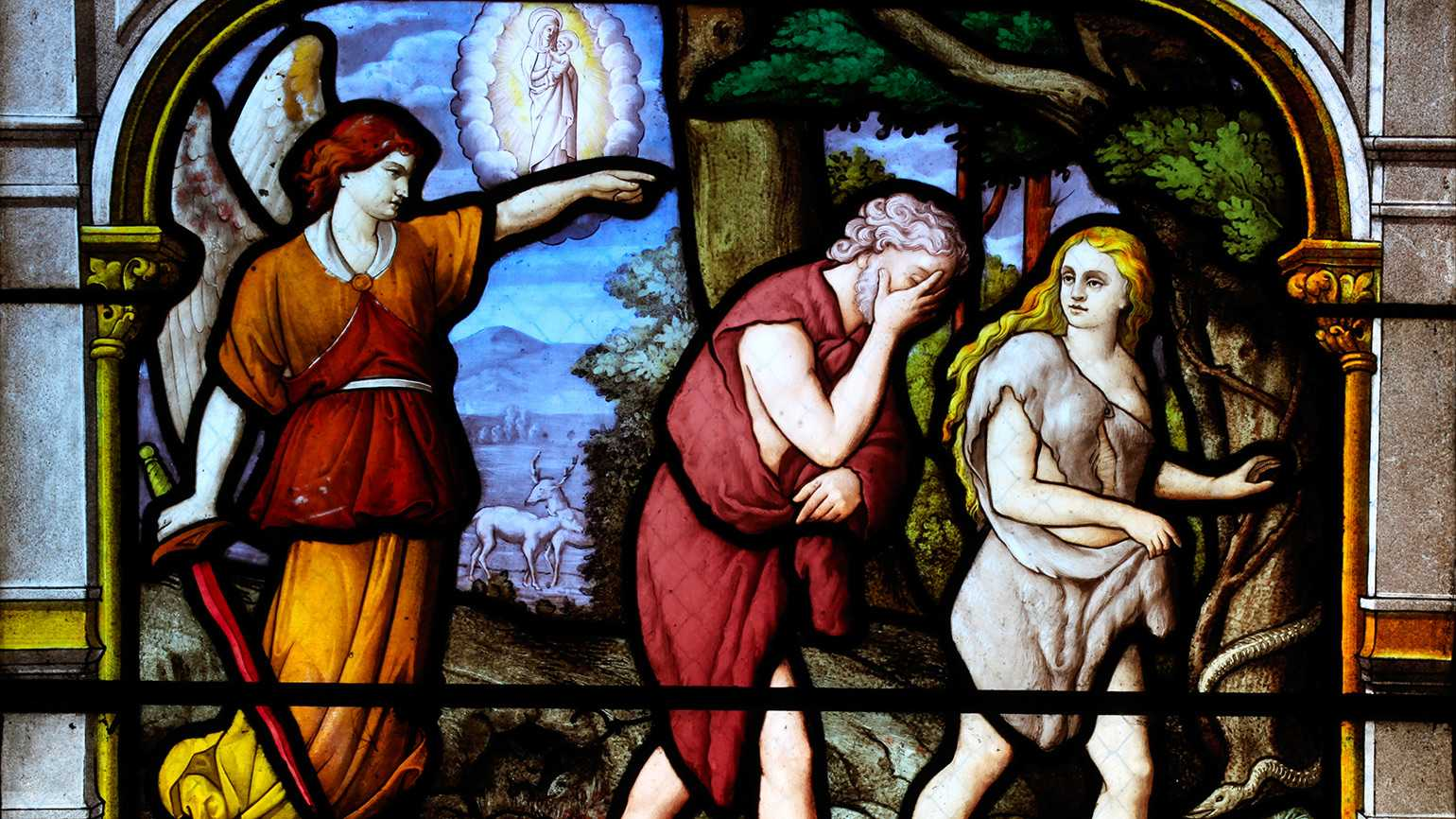 Adam and Eve being banished from the Garden of Eden, depicted in stained glass