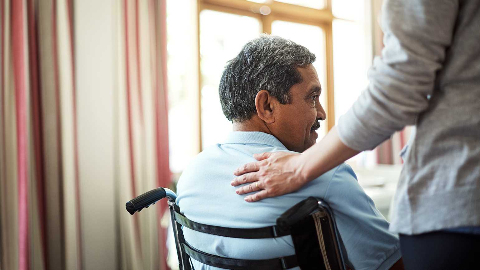 A caregivers looks after a veteran in a wheelchair