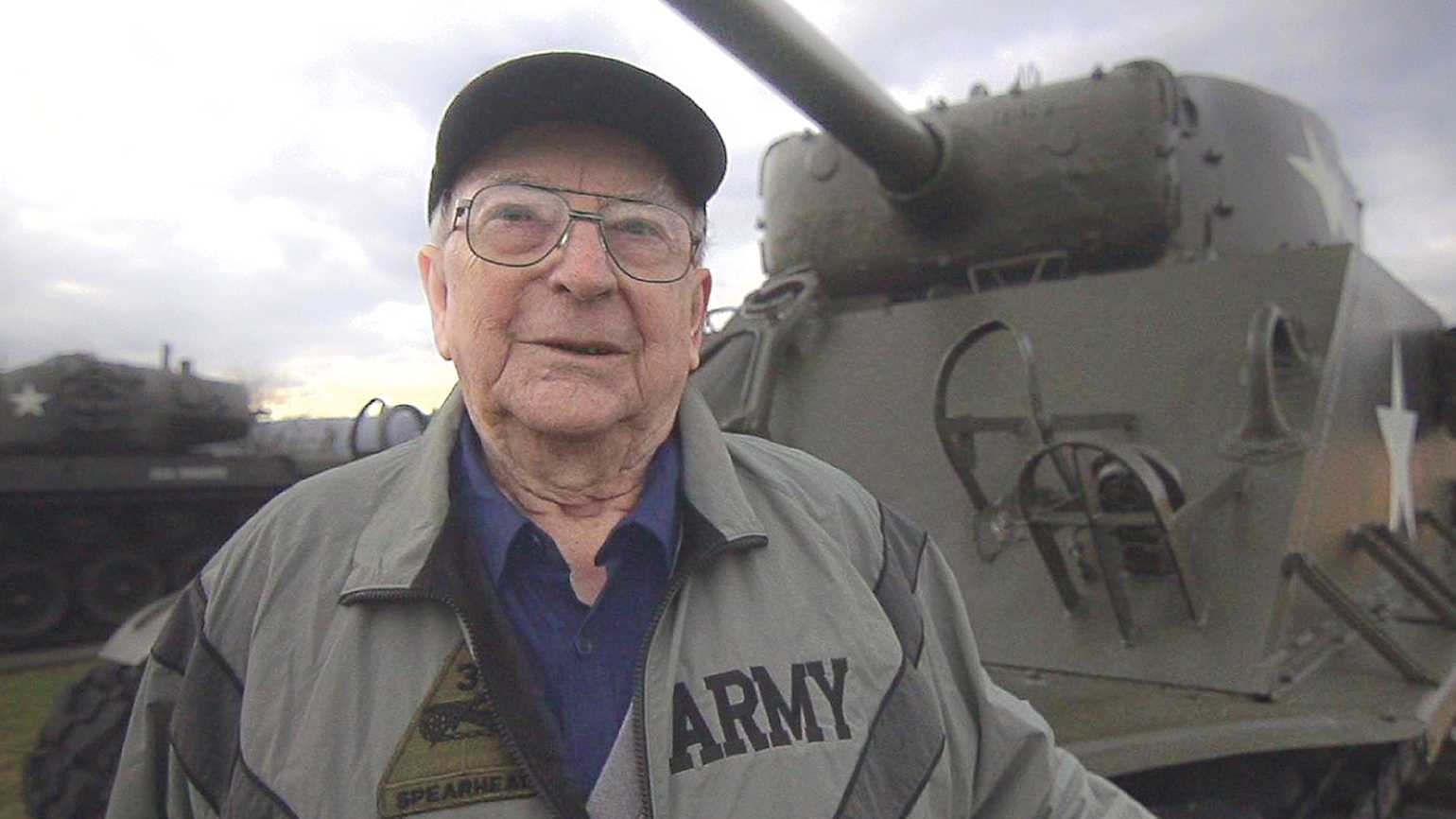 Clarence with a U.S. tank from World War II