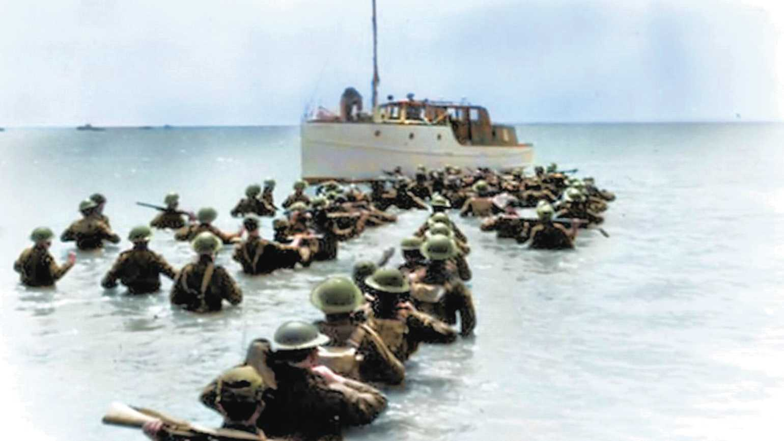 Lines of soldiers wade to a civilian craft rescuing them from Dunkirk.